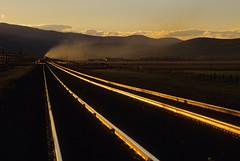 Storming toward Mullan (Moffat Road) Tags: railroad sunset train montana mt smoke rails helena bnsf exhaust mrl glint tobin helpers coaltrain montanaraillink unittrain