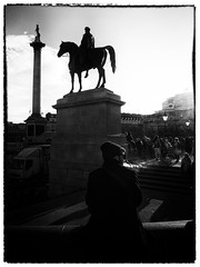 Trafalgar Square Smoker (Feldore) Tags: street light england horse white man black london statue square mono smoke trafalgar blowing olympus smoking mchugh exhale em1 feldore