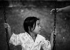 a sense of security (Dexter Gonzaga) Tags: street portrait blackandwhite bw playground children photography blackwhite child hand mother environmental swing
