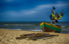 Fishing boat on the beach (OlekGraf) Tags: ocean blue sky orange beach landscape boat boards fishing nikon outdoor poland manfrotto sopot olek d3200 nikonflickraward olekgraf