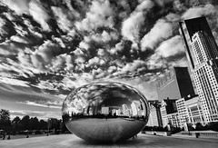 The orb has landed (A Camera Story) Tags: morning blackandwhite usa chicago skyscraper reflections illinois downtown cityscape milleniumpark il cloudgate sigma1020mmf456 sonydslra700