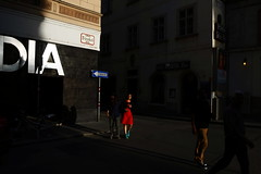 the lady in red ... (rainbowcave) Tags: vienna wien street people woman girl bright hell sunny tourists menschen oneway frau sonnig reddress touristen strase einbahnstrase strobelgasse