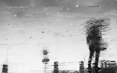 Made of Rain (marcin baran) Tags: rain rainy water reflection puddle fuji fujifilm fujix100 fujix x100 x100t figure person wet black white blackwhite blackandwhite bw mono monochrome gliwice poland polska city urban street streetphotography streetphoto candid pov perspective people woman human element marcinbaran