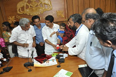 Santosh (CURE)and Shri. Adoor Prakash (Health minister) Updating the success of CURE Clubfoot Kerala to Shri. Oommen Chandy (Chief Minister)