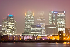 Shrouded in Mist. (Ollie Smalley Photography  Travelling) Tags: street old city london misty thames night hub canon buildings river photography 50mm lights long exposure state district capital ollie wharf docklands canary financial hsbc starburst highrises barclays citi smalley 550d t2i