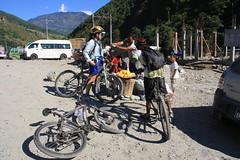 Buying fresh fruit on on a Multi sport treking Mountain biking rafting kayaking trip in Nepal