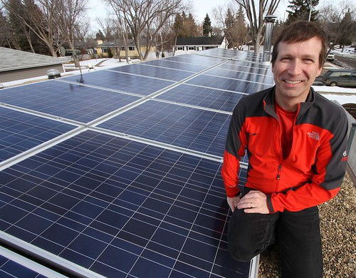 Karl Kovacs on the roof with his 24-panel solar electric system that will produce almost as much electricity as he consumes. - 3