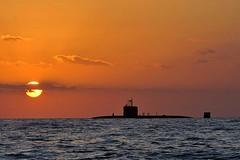 Royal Navy Submarine HMS Triumph Silhouetted i...