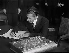 Shahanshah signs Hamburg's Golden Book 1955 (royalist_today) Tags: 1955 iran hamburg mohammed monarch kaiser monarchy emperor shah pahlavi shahanshah aryamehr shahbanu