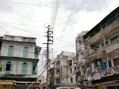 . (Marie Nolle Taine) Tags: street city urban india building town wire asia nowhere pole indore unplace madhyapradesh