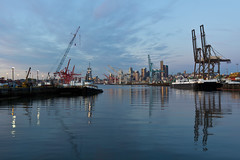 Seattle through East Duwamish waterway (mfeingol) Tags: seattle sunset reflection river evening downtown crane elliottbay harborisland cityline portofseattle duwamish eastwaterway