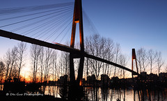 Skytrain Bridge, Surrey BC (PhotoDG) Tags: city bridge sunset color vancouver river cityscape bc wideangle skybridge surrey infrastructure skytrain translink fraserriver newwestminster expo86 lowermainland metrovancouver rapidtransit cablestayed ef1635mmf28liiusm eos5dmarkii kerkhoffhyundai