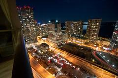 Toronto's waterfront (PiotrHalka) Tags: road city light sky lake toronto ontario canada reflection building cars colors lines night cityscape waterfront sony alpha a500 wwwpiotrhalkacom