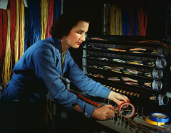 [Woman taping wire, Chrysler Corporation] (SMU Central University Libraries) Tags: woman women working workforce