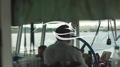 Silhouette Of Captain Steering Boat (alekseiptitsa) Tags: travel cruise vacation people man water wheel standing work river drive boat marine driving ship control yacht skipper captain boating leisure sailor navigation officer navigator helm