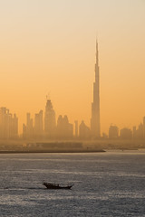 Sunrise in Dubai (Jeffrey Willey) Tags: ocean morning sea water skyline sunrise boat dubai uae unitedarabemirates ae dhow arabianpeninsula burjkhalifa
