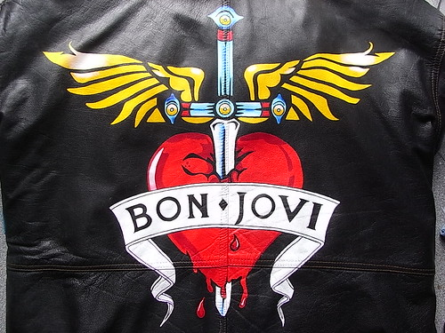 custom painted bon jovi heart and winged dagger logo on a leather