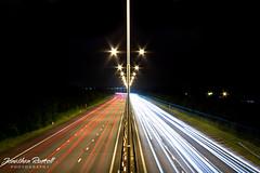 Lightwaves (Jonathan.Russell) Tags: uk red white london car canon lights long exposure flickr russell motorway jonathan release tripod cable symmetry shutter symmetrical temperature m4 watermark illuminate carlight 40d flickraward jonooter