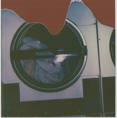 laundry matt (S. Larsen) Tags: old brown polaroid flash under sheets skool laundry developed valentinesday splotches laundrymatt polaroidphotograph theimpossibleproject