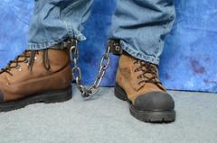 DSC_0082 (jakewolf21) Tags: work boots bondage chain jeans dakota restraints legirons