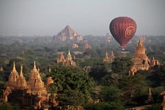 The Time Machine (cormend) Tags: morning travel light orange mist green nature sunrise canon landscape temple eos dawn pagoda asia tour burma buddhist balloon tourist myanmar southeast bagan birmanie 50d balloonsoverbagan cormend