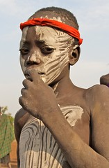 A Mursi Boy (**El-Len**) Tags: africa boy portrait nationalpark child bodypaint omovalley ethiopia tribe ethnic mago surma mursi headband eastafrica fav10 snnpr thegalleryoffinephotography murzu southernnationsnationalitiesandpeoplesregion
