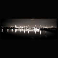 the other bridge (Tony Kearney) Tags: bridge night reflections tmax100 innerharbour portadelaide homedeveloped 1minuteexposure thetomdiverderrickbridge dolphinripples 35mmpan
