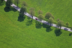 Red Car - 18 (Aerial Photography) Tags: street verde green by landscape traffic aerial grn deu allee redcar luftbild bogen leaftree luftaufnahme lineoftrees bayernbavaria deutschlandgermany rotesauto laubbaum strase deciduoustree baumreihe rowoftrees landstrase foliagetree 03052008 fotoklausleidorfwwwleidorfde 1ds04383 st2103