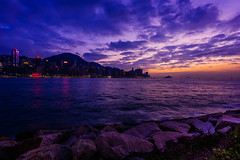 purple sunset (dawvon) Tags: world ocean china city travel sunset sea sky urban hk cloud seascape nature colors night dark landscape hongkong twilight rocks asia cityscape skyscrapers purple nightshot harbour stones promenade   kowloon     hongkongisland  victoriaharbour                 kowloonwest westkowloonwaterfrontpromenade