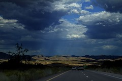 Chasing the light (Enoch Joseph Wetsy) Tags: light mountains rain clouds highway driving lasvegas darkclouds nevadadesert grantcanyon