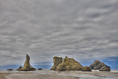 Assemblages Of Grandeur (El Justy) Tags: ocean light summer sky nature water clouds oregon reflections j landscapes waves shadows seascapes wind overcast calm pacificocean pacificnorthwest oregoncoast geology bandon breeze pnw pacificcoast seastacks waterscapes salmahayek southerncoast facerock tonemapping jri cooscounty justinrice riceimages mygearandme mygearandmepremium mygearandmebronze mygearandmesilver mygearandmegold eljusty assemblagesofgrandeur
