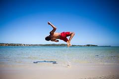 Beach fun! [EXPLORED!] (Luis Picolo) Tags: blue boy red guy praia beach water swim canon jump sand mod capoeira l 5d homem mozambique maputo mocambique rapaz bilene