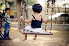 Swing (abhiomkar) Tags: india playing girl kids canon garden lens 50mm prime kid bokeh f14 14 bangalore swing