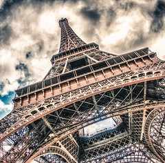 ~ drama at the Eiffel Tower ~ (Janey Kay) Tags: sky paris clouds himmel cu explore ciel cielo squareformat toureiffel nuages nuvem puddles nube 2012 wolden nikkor105mmfisheye formatcarr flaquesdeau sigma2470mm28 winterhiver january2011 janeykay nikond300s janvier2011 januaryjanuarjanvier