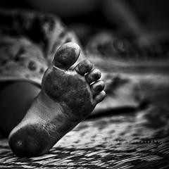    Tender foot (ayashok photography) Tags: bw india black asian foot blackwhite kid nikon asia indian streetphotography streetlife dirt desi chennai bnw tamilnadu bharat bharath desh barat barath nikkor24120mm ayashok nikond300 walltaxroad aya2481