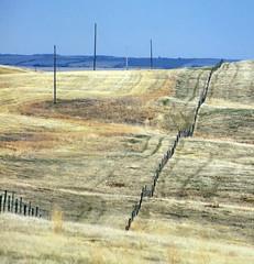 SKSW12d41 Prairie Farm Fences, Clinworth SK (CanadaGood) Tags: blue brown canada color colour fence farm powerlines sk prairie saskatchewan agriculture 2012 canadagood clinworth thisdecade