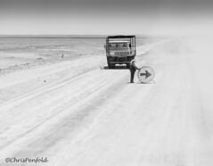 Desert Roadworks (chrispenfold) Tags: africa road woman white black blackwhite desert roadworks roadside dust namibia scrub afrique namib roadworker