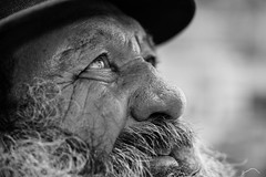 The gaze of hope (Giulio Magnifico) Tags: life lighting old inspiration man black detail reflection eye up closeup composition hope alone loneliness emotion expression character homeless profile longhair citylife thoughtful streetphotography streetportrait sharp thoughts elder aged bonnet gaze glance clochard udine nikond800e nikkormicro105mmafsvrf28