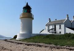 Highland Lighthouse (Ian Jackson 1974) Tags: blue sea white house beach water grass scotland highlands hill shoreline