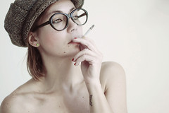 tutto il resto  noia (mickiky) Tags: portrait woman selfportrait me myself glasses donna cigarette smoke smoking cap autoritratto remotecontrol cappello autoscatto occhiali sigaretta