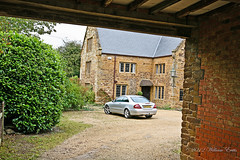 Kilsby, Northamptonshire. View through the coach house entrance. (Bill E2011) Tags: england history beauty canon village northamptonshire saxon danes anglo saxons kilsby 1000years