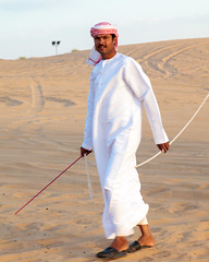 """Safari"" in UAE - this man had the job of leading the camels around the compound as tourists ride (MomentaryShutter) Tags: people nature ecology animal animals person sand scenery dubai desert wildlife middleeast camel human arab land beast environment creatures creature ethnic mammals environmentalism sharjah unitedarabemirates humanbeing beasts humans ethnicity ecosystem zoology humanbeings ruminant ruminants arabiandesert undomesticatedanimals"