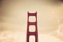 The North Tower (Leighton Wallis) Tags: sanfrancisco california birthday ca bridge red usa tower clouds suspension unitedstatesofamerica goldengatebridge cables internationalorange 75thanniversary ggnpc11
