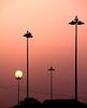 Urban sunset (Robyn Hooz) Tags: street sunset sun fog canon disco eos tramonto zoom wires layer luci sole nebbia lampioni fili humid umido silouhettes strato sagome 550d efs18135is