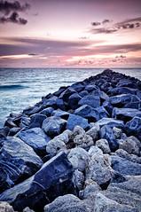 South Pointe (Tony Curulli) Tags: ocean travel usa seascape beach water sunrise dawn nikon rocks break florida miami miamibeach 1635 southpointe d90 leadingline