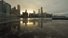 Sunset at Olive Park (Seth Oliver Photographic Art) Tags: chicago buildings reflections landscapes illinois nikon midwest skyscrapers iso400 cities cityscapes sunsets lakemichigan pinoy downtownchicago johnhancockbuilding circularpolarizer chicagoskyline urbanscapes secondcity windycity chicagoist d90 olivepark cityofbigshoulders aperturef90 perfectsunsetssunrisesandskys manualmodeexposure setholiver1 sunsetinchicago 1100secondexposure wbsettocloudy streetervilleneighborhood 10124mmtamronuwalens camerasetongranitebenchduringshot croppedto16x9panoramicformat