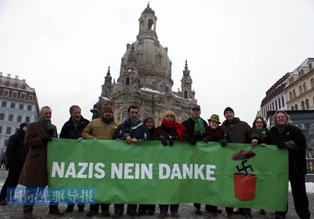 Members of Germanys Green Party stand in front of the Frauenkirche (Church of Our Lady) in Dresden to protest against an Ultra-right activists march through the city