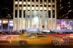 Apple Store, Fifth Avenue (peterotoole) Tags: christmas newyorkcity light people usa newyork blur cars apple glass yellow retail architecture america photoshop iso