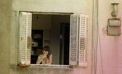 Vicky de dia (Ms. Paprika) Tags: windows building texture textura window argentina girl ventana buenosaires chica thoughtful ventanas blonde rubia neighbor fumando monserrat pensativa vecina girlsmoking chicafumando