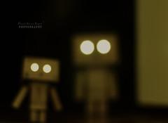 Close encounters of the Danbo kind (.OhSoBoHo) Tags: nightphotography cute canon toy 50mm bokeh manga aliens spooky doorway kawaii sparkling wormseyeview odc yotsuba danbo amazoncojp cardboardrobot deliberateblur revoltech eyeslit canoneos40d danboard bokehthursday odct danbolove danbophotography